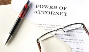 power of attorney, Philadelphia estate administration attorneys, legal advice, legal assistance, pen, legal documents, glasses